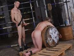 Joey is corded down over the barrel, his flesh shortly caned and his face unloaded with jizz!